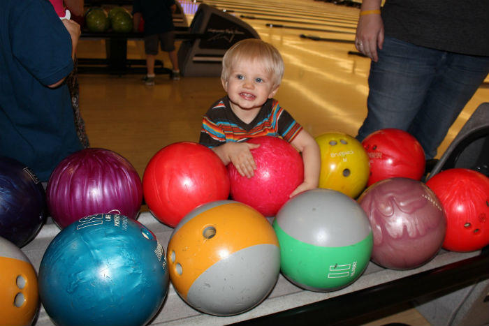 boy with bowling balls