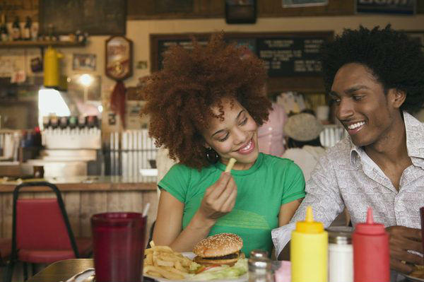 couple eating burgers and fries
