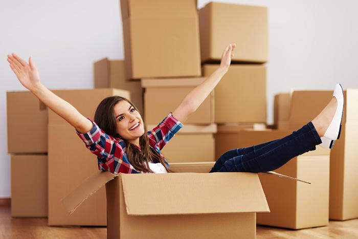 girl inside cardboard box