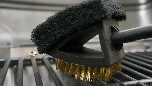 cleaning grill with brush