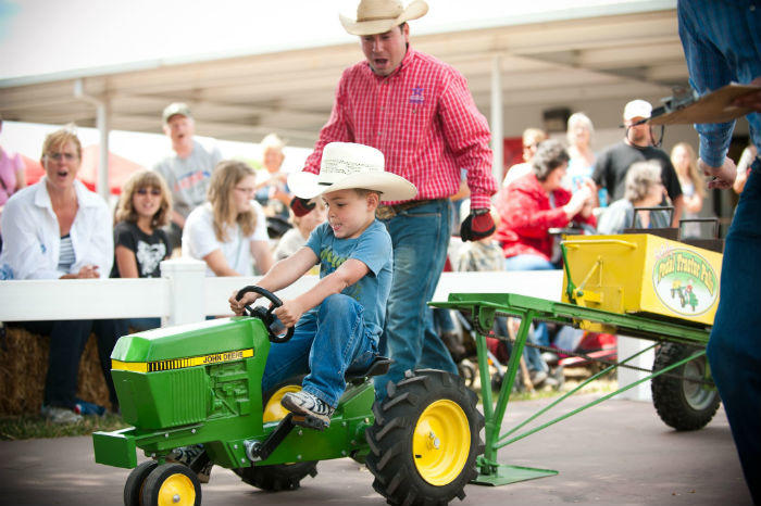 boy doing tractor pull