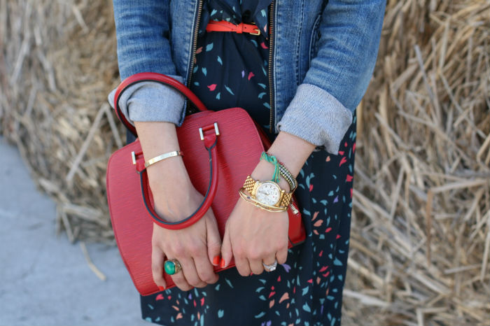 woman holding red handbag
